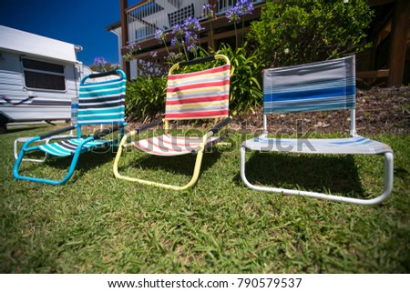 Colorful of beach chairs on the front yard #790579537