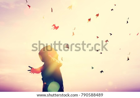 Freedom feel good and travel adventure concept. Copy space of silhouette man rising hands on sunset sky double exposure colorful bokeh and bird fly background. Vintage tone filter effect color style. Royalty-Free Stock Photo #790588489