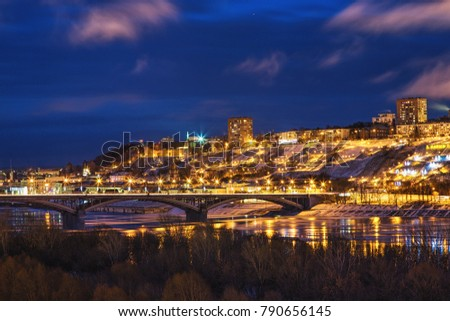 Panoramic view of historical part of Nizhny Novgorod with Kremlin and bridge over river Oka in evening time #790656145