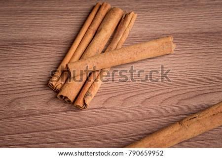 cinnamon sticks on wooden table. #790659952