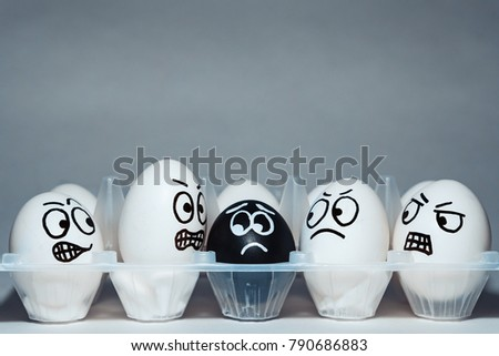 Faces on chicken eggs in the form of facial expressions, reflecting emotions. The concept of racism, misunderstanding, a barrier in relations, denial of society. Barriers between people, prejudice. #790686883
