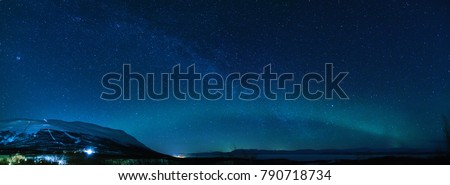 Winter panorama with Milky way and Northen lights phenomenon starting Aurora Borealis in Lapland scandinavia. #790718734