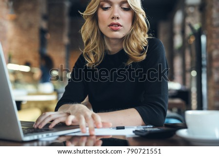 business woman behind laptop in cafe                                #790721551