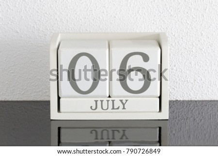 White block calendar present date 6 and month July on white wall background #790726849