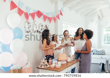 Baby shower. Group of diverse women together at baby shower. Smiling young pregnant woman celebrating baby shower with best friends. #790759816