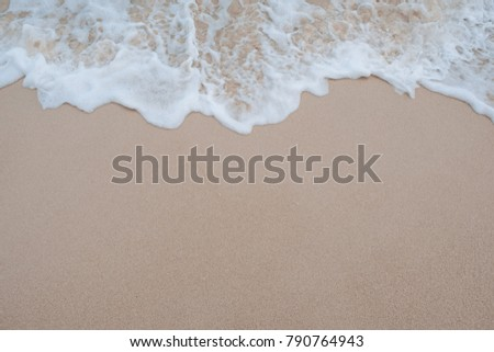 Top view image of waves on tropical white beach with sand #790764943