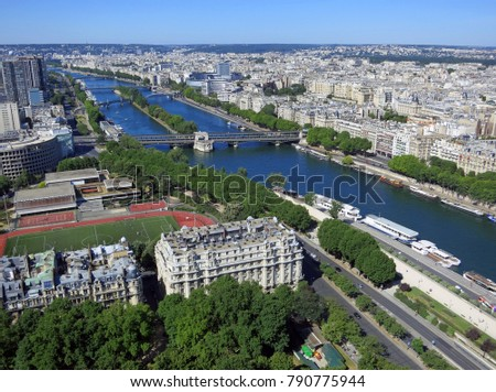 Panoramic view of Paris looking southwest from the Eiffel Tower to the green-blue artery of the Seine river featuring the Pont de Bir-Hakeim. June 2015 #790775944