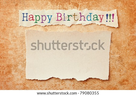 Paper with ripped edges on grunge paper background. Happy birthday card