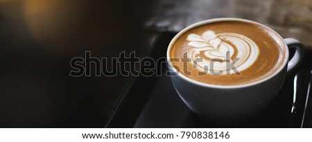 Close up of hot latte coffee in the cafe, photo banner for website header design with copy space for text #790838146