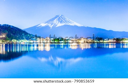 At lake Kawaguchi (Kawaguchiko),Yamanashi,Japan, Mt, Fuji can be seen along this lakeside. In winter,snow covered its peak.This night sky is clear and full of star. Tourist rest in warm light up hotel #790853659