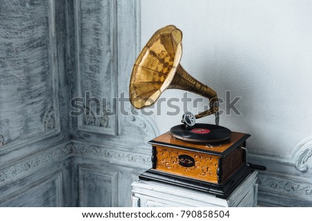 Music device. Old gramophone with plate or vinyl disk on wooden box. Antique brass record player. Gramophone with horn speaker. Retro entertainment concept. Royalty-Free Stock Photo #790858504
