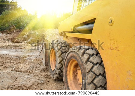 Small bulldozer does the work #790890445