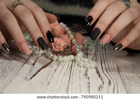 fashionable beautiful manicure with pearls and flowers #790980211
