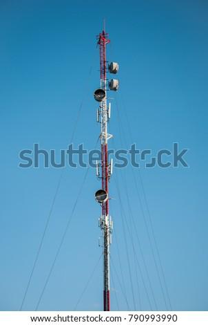 telecommunication mast TV antennas wireless technology,Satellite pillar base station with blue sky. #790993990