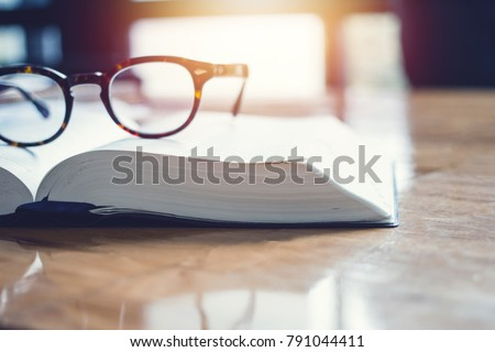 vintage glasses,on books stack in public library book, Studying examining. Tutor books with friends. Young students campus helps friend catching up and learning. People, learning, education #791044411