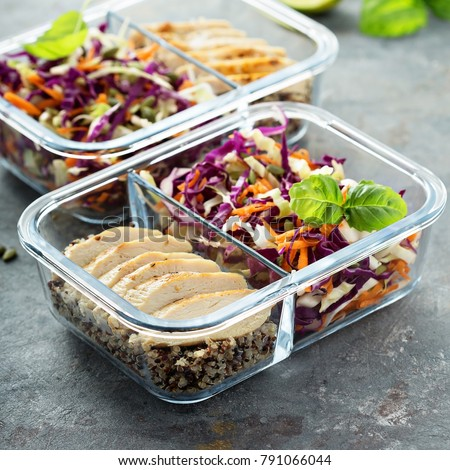 Healthy meal prep containers with quinoa, chicken and cole slaw #791066044