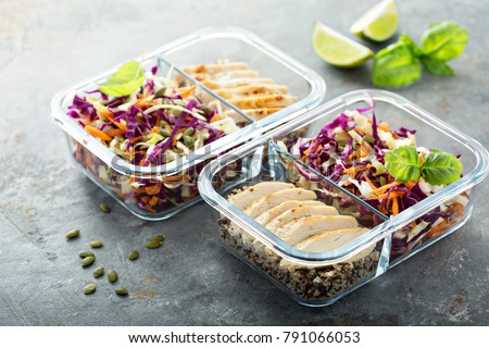 Healthy meal prep containers with quinoa, chicken and cole slaw #791066053