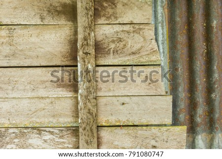 Hardwood wall and rusty steel plate close up for background #791080747