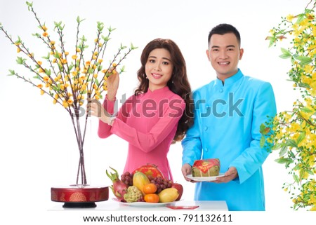 Young couple preparing table for spring festival celebration #791132611