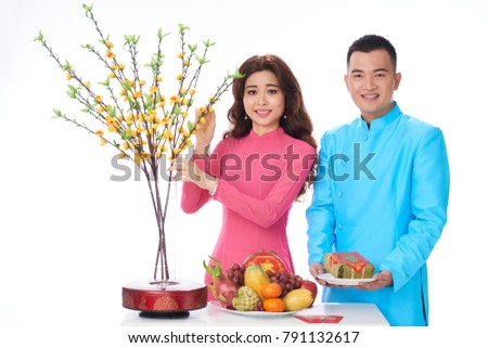 Cheerful Asian couple at table served for Tet celebration #791132617