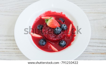 Summer pudding with berries sauce #791210422