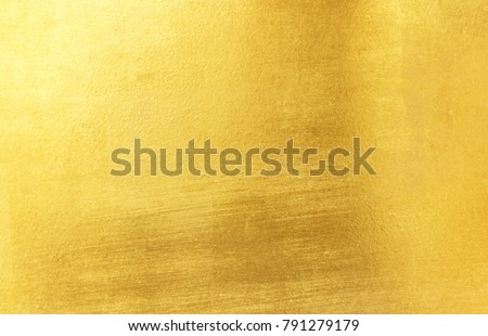 Shiny yellow leaf gold foil texture background #791279179