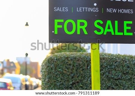 For Sale sign displayed on London street in the UK