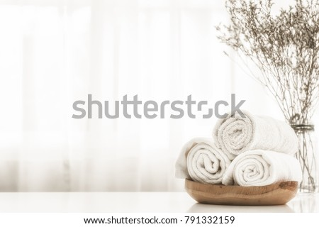 Towels on wood plate with copy space blurred bathroom background. For product display montage. #791332159