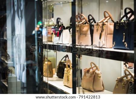 Fashion woman handbags on the shelf of store. #791422813