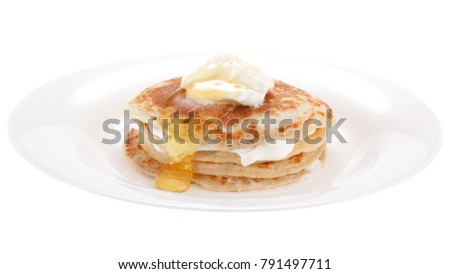 Serving pancakes with sour cream and honey on the plate. Isolated on white background. #791497711
