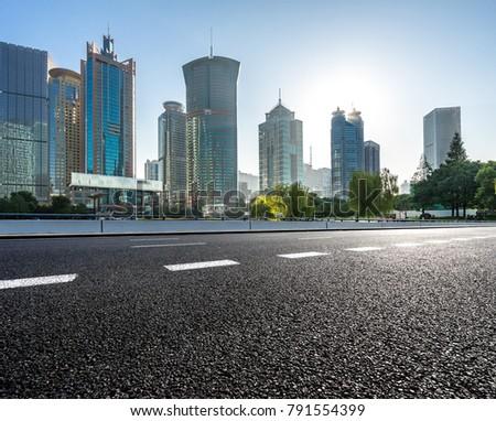 empty asphalt road front of shanghai cityscape #791554399