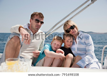 Family sitting together on yacht #791698108
