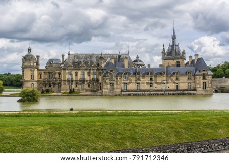 External view of famous Chateau de Chantilly (Chantilly Castle, 1560). Chantilly Castle - a historic chateau located in town of Chantilly, Oise, Picardie, France. #791712346