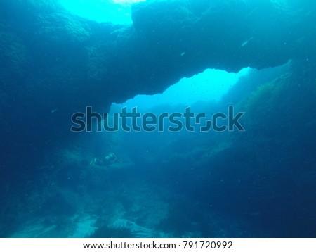 Arch and scuba diver underwater #791720992