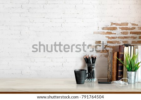 Workspace Mock up marble tabletop with vintage books, pencils and houseplant. copy space desk with copy space for products display montage. Royalty-Free Stock Photo #791764504