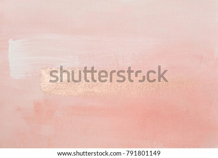 Handmade modern subtle pink abstract painted background texture with shiny metallic golden brush stroke