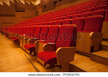 Red seats in the auditorium quietly and without people #791856745
