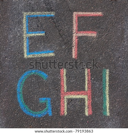 Alphabet letters drawn on asphalt with chalk, e, f, g, h, i