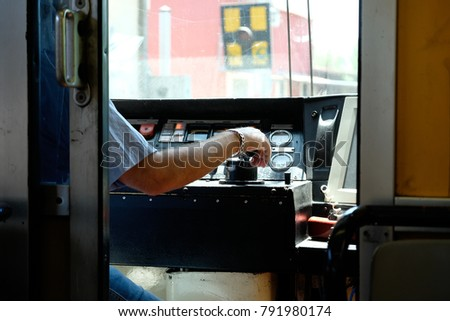 Train driver's hand on controls #791980174