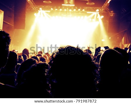 Concert hall with crowd clapping in front of the stage #791987872