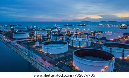 Aerial view storage tank farm at night, Tank farm storage chemical petroleum petrochemical refinery product at oil terminal, Business commercial trade fuel and energy transport by tanker vessel. #792076906