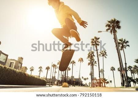 Skater boy on the street in Los angeles. Skateboarding in venice, California #792150118