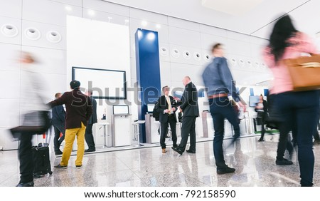 crowd of business people at a trade show booth #792158590