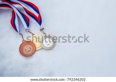 Gold, silver bronze medal. White snow background. Wallpaper for February winter olympic game in South Korea. #792246202