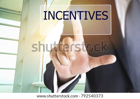 Businessman hand touching INCENTIVES button on virtual screen #792540373