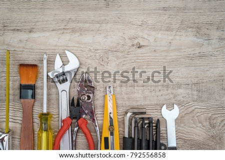 Craftsman tools on grunge wooden background. Assorted work tools set for background. #792556858