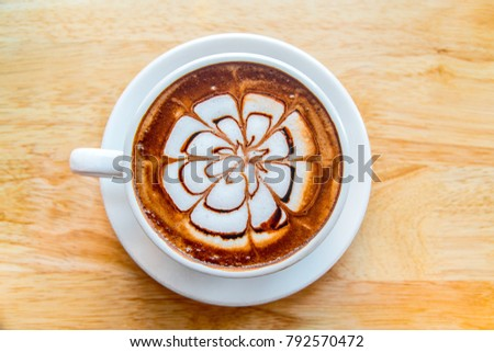 hot coffee mocha latte on wooden table background #792570472