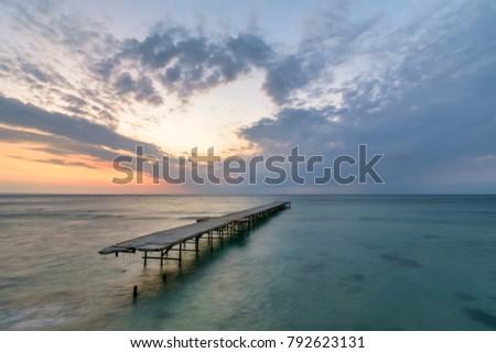 Concrete broken bridge in the sea against a vibrant sunrise in Varna, Bulgaria  #792623131
