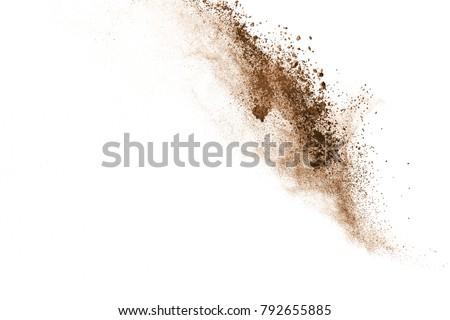 Dry soil explosion on white background. Royalty-Free Stock Photo #792655885