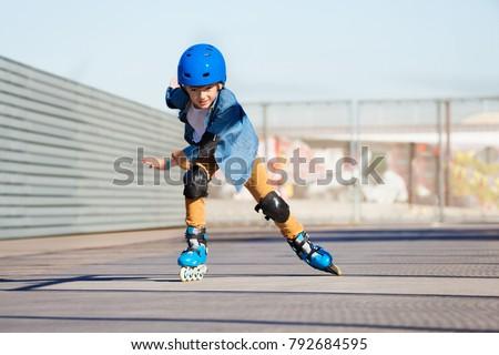 Boy riding on roller skates at outdoor  skate park